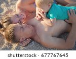 mom dad son at pebble beach | Shutterstock . vector #677767645