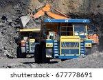 open pit coal mine. loading... | Shutterstock . vector #677778691