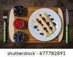 pancakes on wooden background... | Shutterstock . vector #677782891