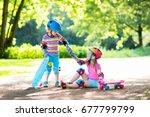 children riding skateboard in... | Shutterstock . vector #677799799