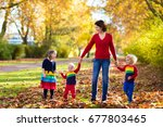 mother and kids play in autumn... | Shutterstock . vector #677803465