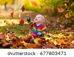 Kids Play In Autumn Park....