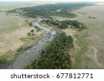 aerial view of the mara river | Shutterstock . vector #677812771
