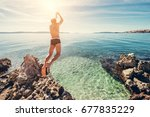 man jumps in clear crystal... | Shutterstock . vector #677835229
