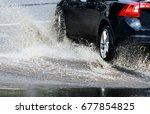 car splashes through a large...   Shutterstock . vector #677854825