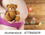 happy pregnant woman | Shutterstock . vector #677860639