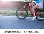beautiful woman riding on bike | Shutterstock . vector #677868151