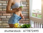 fit woman drinking vegetable... | Shutterstock . vector #677872495