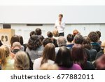 female speaker giving... | Shutterstock . vector #677882011