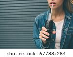 Small photo of drinks, people and lifestyle concept - close up of happy woman drinking cola with straw at home