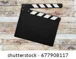 Movie Clapperboard On Wooden...