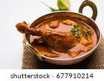 spicy reddish chicken curry  ... | Shutterstock . vector #677910214