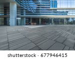 empty pavement and modern... | Shutterstock . vector #677946415