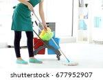 Woman Washing Floor In Office....
