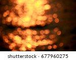 bokeh sunset on the river | Shutterstock . vector #677960275