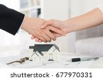 house agent successfully... | Shutterstock . vector #677970331