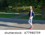 Young Woman Athlete Walking Th...