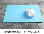 blank mat and wireless mouse on ... | Shutterstock . vector #677992315