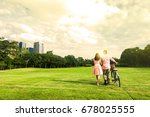 a couple walk with bicycle in... | Shutterstock . vector #678025555