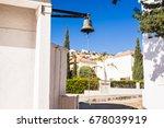 a large bell next to the door ... | Shutterstock . vector #678039919