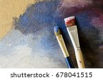 Brushes On The Background Of A...