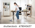 happy young woman cleaning the...   Shutterstock . vector #678043657