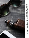 vaping device on the wooden...   Shutterstock . vector #678066025