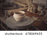 clay pot on a potter's wheel... | Shutterstock . vector #678069655