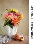 Dahlia Flowers in Vase with Peach fruit - stock photo