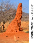 Small photo of Termite mound in Twyfelfontein (Afrikaans: uncertain spring), officially known (Damara/Nama: jumping waterhole), is a site of ancient rock engravings in the Kunene Region of north-western Namibia.