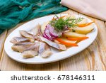 Stock photo herring with potatoes and onions 678146311