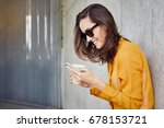 joyful young woman texting and... | Shutterstock . vector #678153721