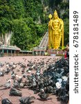 Small photo of Lots of pigeons in front of the tallest Lord Murugan statue in the world; 42.7-metre high at the entrance of Batu Caves, Kuala Lumpur, Malaysia.
