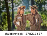two scouts are reading a book... | Shutterstock . vector #678213637