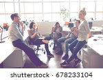 group of a young business... | Shutterstock . vector #678233104