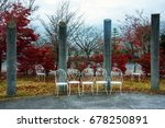 retro white chairs in fall... | Shutterstock . vector #678250891