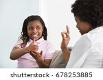 smiling young mother learning... | Shutterstock . vector #678253885