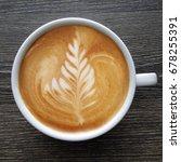 top view of a mug of latte art...   Shutterstock . vector #678255391