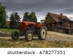 Rustic Tractor And House On A...