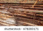 Rough Cut Planks Stacked In A...