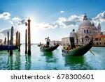 ride on gondolas along the gand ... | Shutterstock . vector #678300601