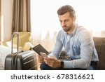 Stock photo young man business traveler hotel room accomodation 678316621