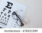 eye glasses on eyesight test... | Shutterstock . vector #678321589