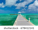 pier on the caribbean sea at... | Shutterstock . vector #678412141