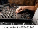 the dj's hand on the dj mixer.... | Shutterstock . vector #678421465