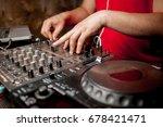 the dj's hand on the dj mixer.... | Shutterstock . vector #678421471