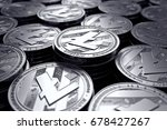 Litecoin coins (LTC) in blurry closeup. New cryptocurrency and modern banking concept. 3D rendering.