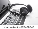 headset and computer laptop ... | Shutterstock . vector #678430345