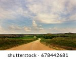 a dirt back country road winds...   Shutterstock . vector #678442681