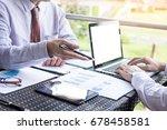 business people discuss... | Shutterstock . vector #678458581
